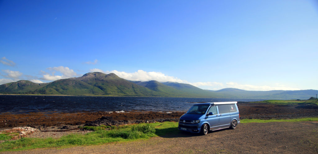 VW T6 campervan by loch in Scotland