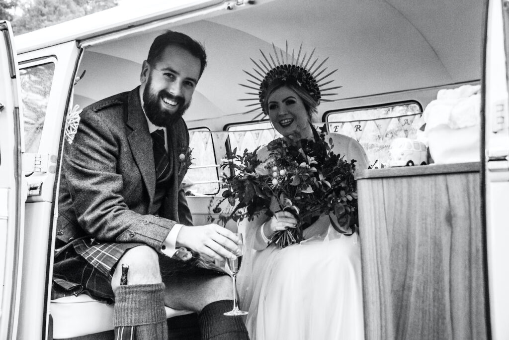 VW Wedding campervan interior bride and groom with champagne. Deeside Classic Campers Glen Tanar