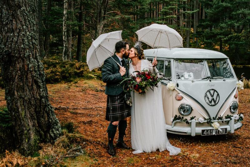 wedding campervan bride and groom kissing Glen Tanar Deeside Classic Campers